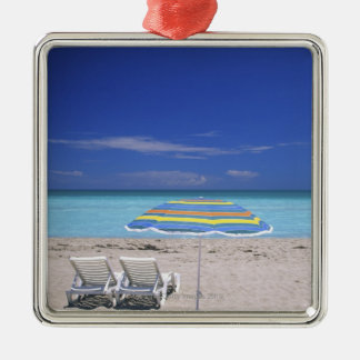 Umbrella and two lounge chairs on beach, Miami Silver-Colored Square Decoration