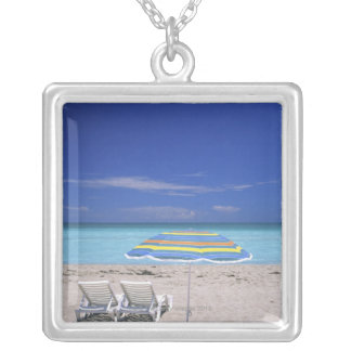 Umbrella and two lounge chairs on beach, Miami Silver Plated Necklace