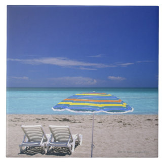 Umbrella and two lounge chairs on beach, Miami Tile
