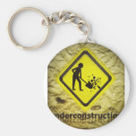 under construction sign key chain