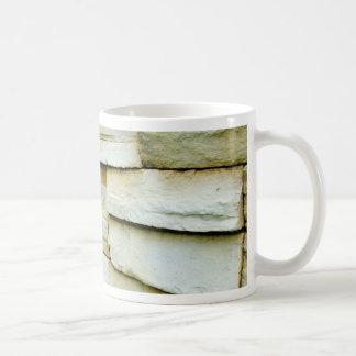 Uneven brick wall mugs