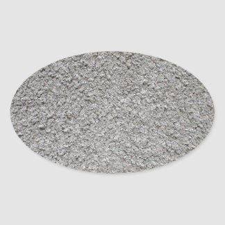 Uneven surface of the gray cement oval sticker