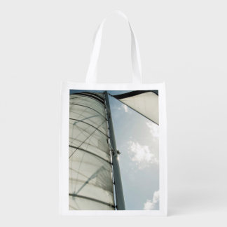 Unfold cruise sail down the blue sky reusable grocery bag