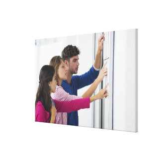 University students checking bulletin board for canvas print