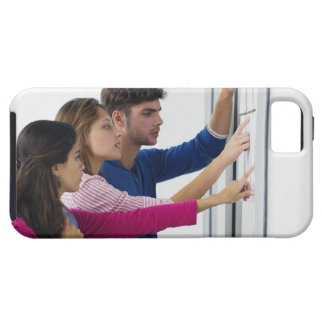 University students checking bulletin board for case for the iPhone 5