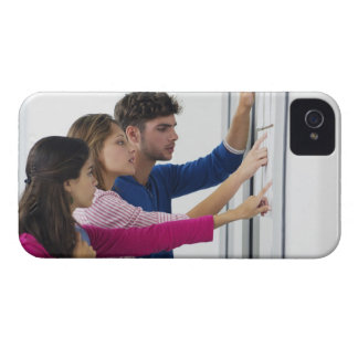 University students checking bulletin board for iPhone 4 cover