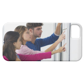 University students checking bulletin board for iPhone 5 cover
