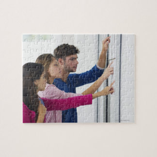 University students checking bulletin board for puzzle