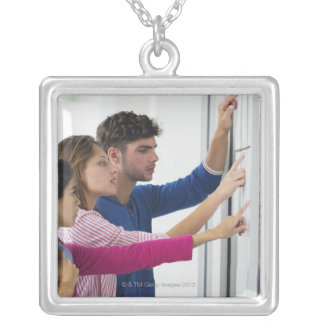 University students checking bulletin board for silver plated necklace