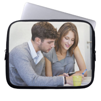 University students text messaging while using laptop sleeve