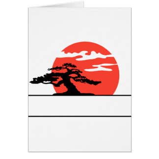Upright bonsai against sun with box for text note card