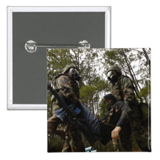 US Air Force Airmen carry a simulated casualty 15 Cm Square Badge