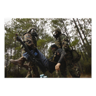 US Air Force Airmen carry a simulated casualty Photo Print