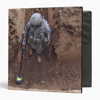 US Army Specialist searches for a weapons cache Binders