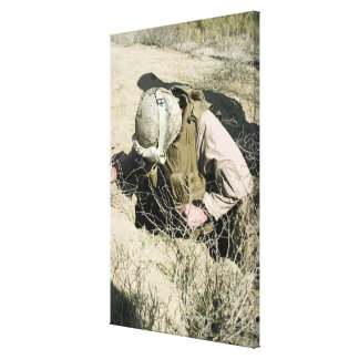US Marine jumps down a hole Canvas Print