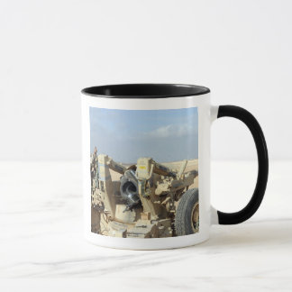 US Marines prepare to fire a howitzer 2 Mug