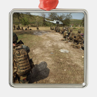US Marines provide security as a UH-1N Christmas Ornament
