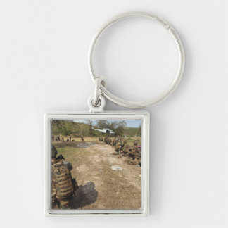 US Marines provide security as a UH-1N Key Ring