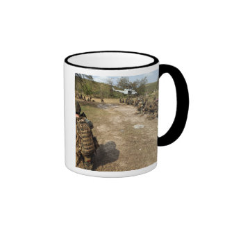 US Marines provide security as a UH-1N Ringer Mug