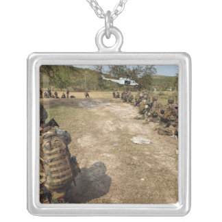 US Marines provide security as a UH-1N Silver Plated Necklace