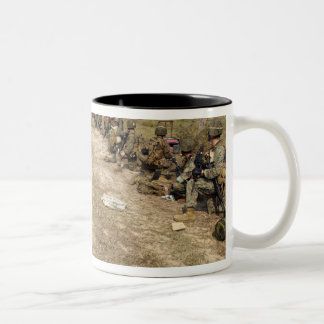 US Marines provide security as a UH-1N Two-Tone Mug