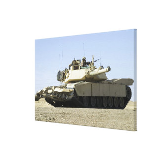 US Marines provide security in a battle tank Canvas Print