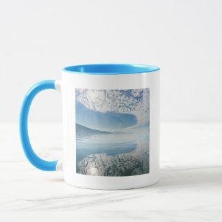 USA, Alaska, Freshwater Bay. Clouds Reflected Mug