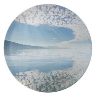 USA, Alaska, Freshwater Bay. Clouds Reflected Party Plates
