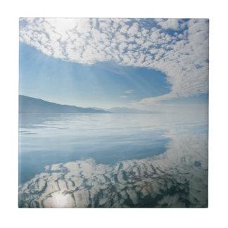USA, Alaska, Freshwater Bay. Clouds Reflected Tile