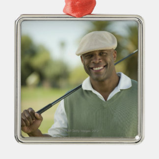 USA, Arizona, Scottsdale, Smiling man on golf Christmas Ornament