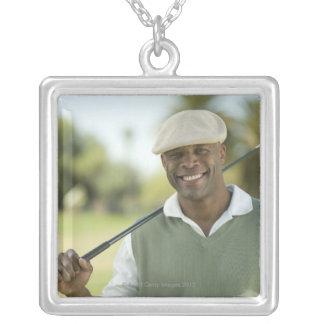 USA, Arizona, Scottsdale, Smiling man on golf Silver Plated Necklace
