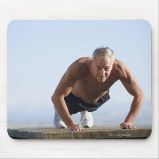USA, California, Berkeley, Senior man exercising Mouse Pad