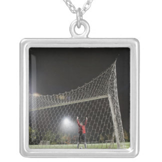 USA, California, Ladera Ranch, Football player Silver Plated Necklace