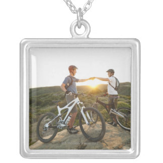 USA, California, Laguna Beach, Two bikers on Silver Plated Necklace