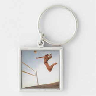 USA, California, Los Angeles, woman playing 2 Silver-Colored Square Key Ring