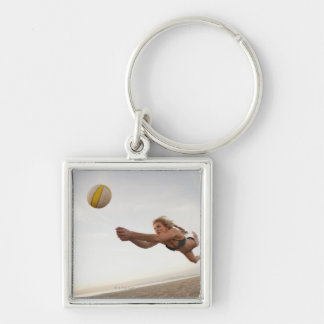 USA, California, Los Angeles, woman playing Silver-Colored Square Key Ring