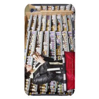 USA, California, San Rafael, Woman shopping in Barely There iPod Covers