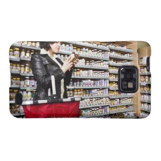 USA, California, San Rafael, Woman shopping in Galaxy S2 Covers