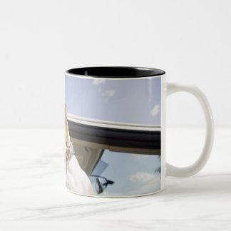 USA, Colorado, dog looking through car window 2 Two-Tone Coffee Mug