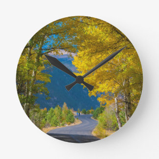 USA, Colorado. Road Flanked By Aspens Round Clock