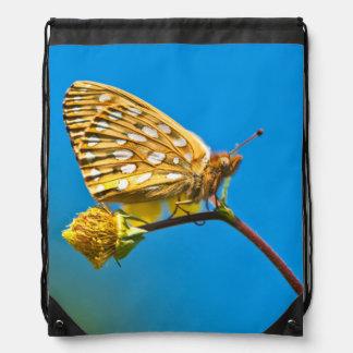 USA, Colorado. Skipper butterfly on flower stem Drawstring Bag