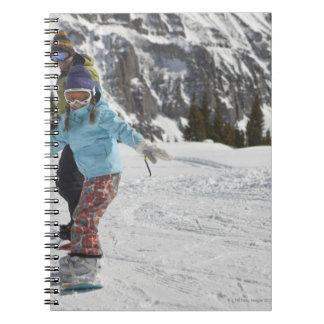 USA, Colorado, Telluride, Father and daughter 2 Notebooks