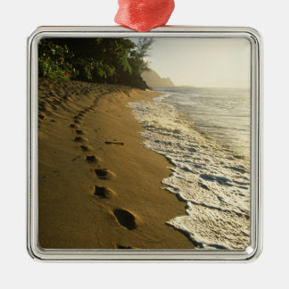 USA, Hawaii, Hanalei. Footprints in sand. Christmas Ornament