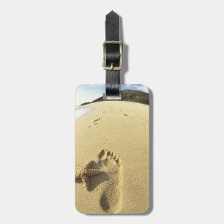 USA, Hawaii, Maui, Makena Beach, Footprint and Luggage Tag