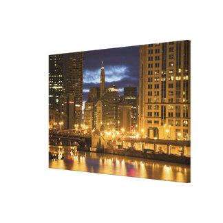 USA, Illinois, Chicago skyline illuminated at Canvas Print