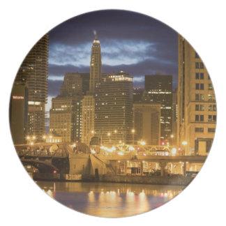 USA, Illinois, Chicago skyline illuminated at Plates