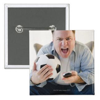 USA, Jersey City, New Jersey, man holding remote Pin