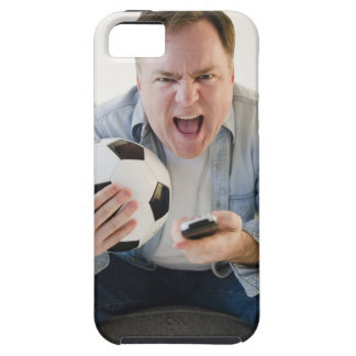 USA, Jersey City, New Jersey, man holding remote Case For The iPhone 5
