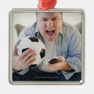 USA, Jersey City, New Jersey, man holding remote Christmas Ornament