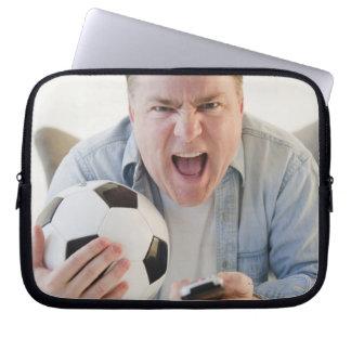 USA, Jersey City, New Jersey, man holding remote Laptop Sleeve